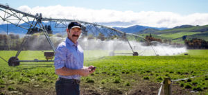 David Croft with a pivot irrigation system in the background